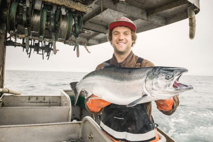Man holding giant salmon