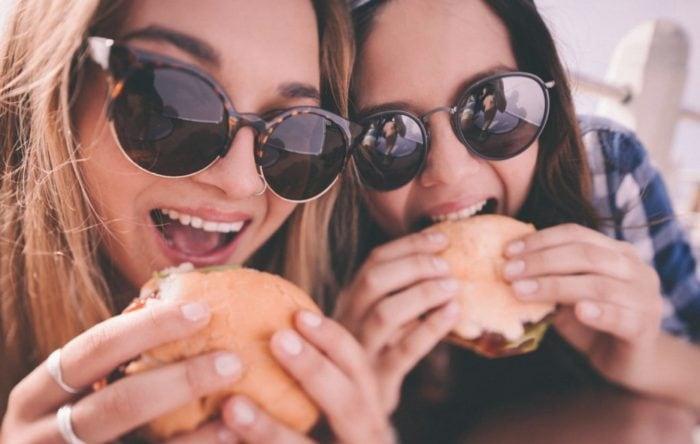 Girls eating burgers