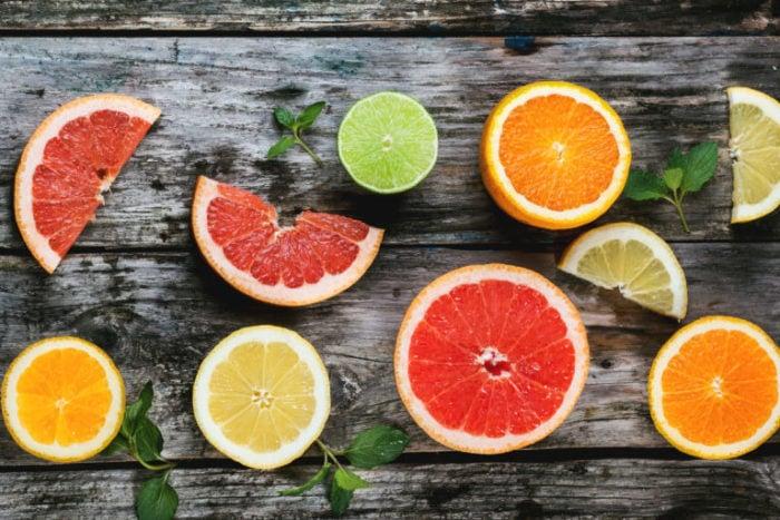 Set of sliced citrus fruits lemon, lime, orange, grapefruit